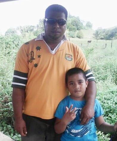 In happier days... Rebaio Mekieru with seven-year-old son Mosese.