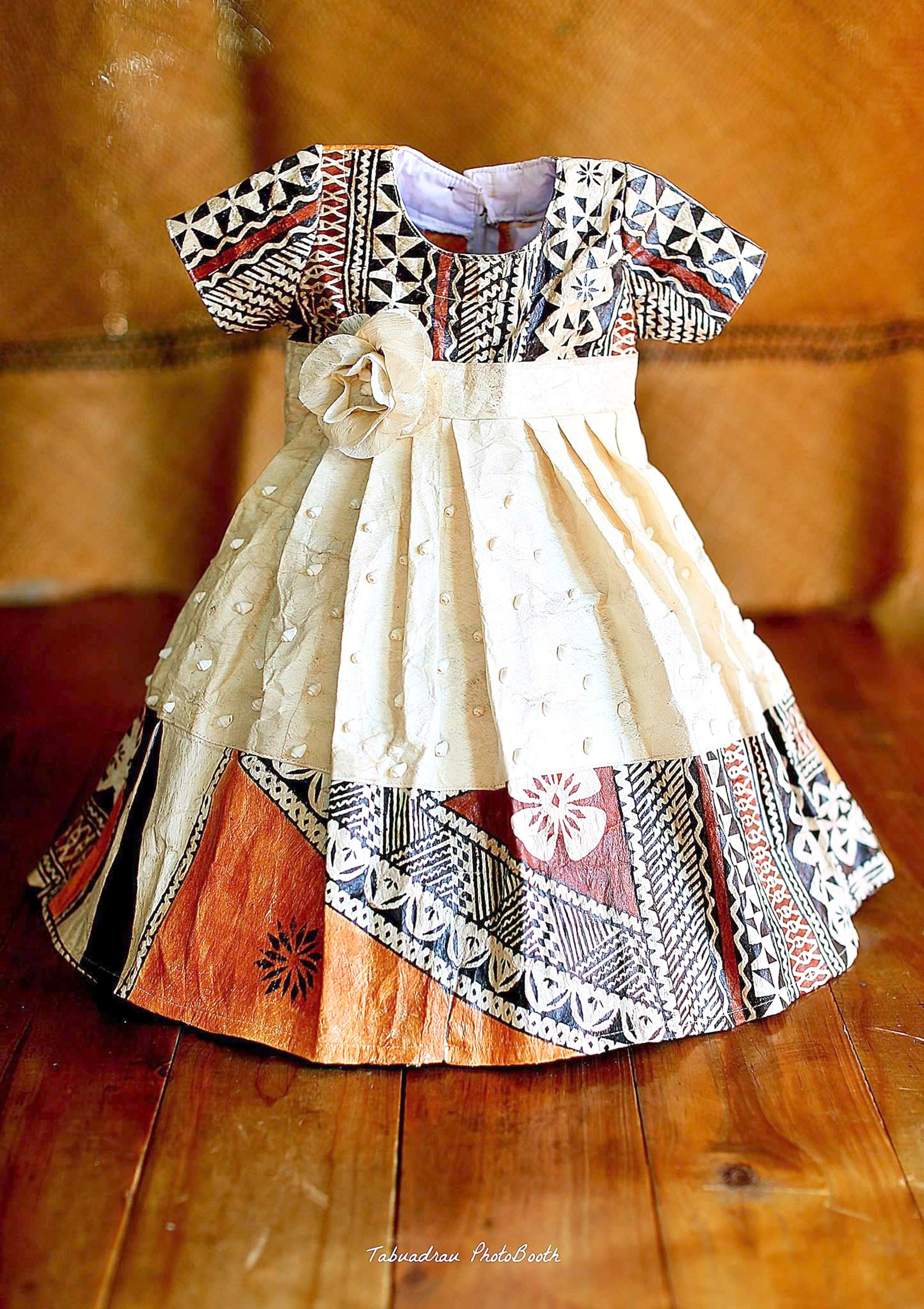 A tapa shirt and dress created by Tabuadrau Designs.