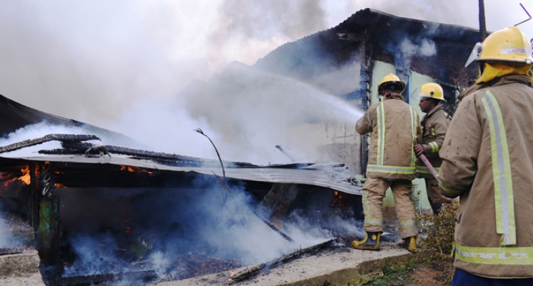 Mother weeps as she watches fire destroy 4-bedroom home