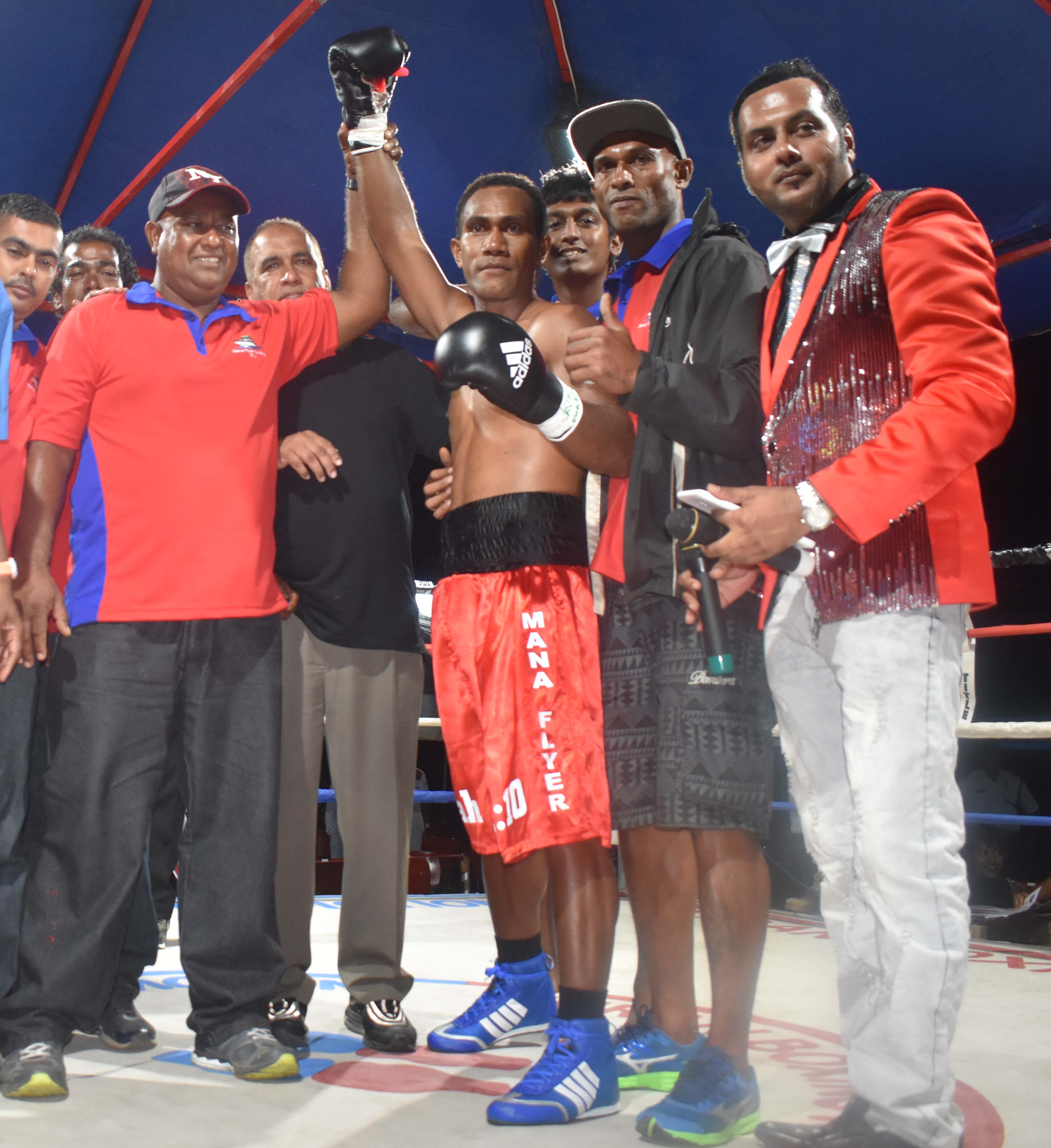 Siliveni Nawai with fans at the end of the boxing programme at the Prince Charles Park in Nadi last Friday night. Photo: WAISEA NASOKIA