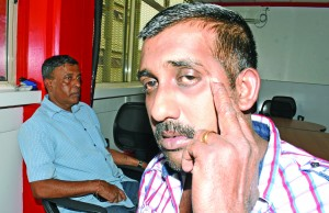 Taxi owner Karam Chand Gandhi (left), with his son and driver Shelvin Chand. Photo: Ronald Kumar