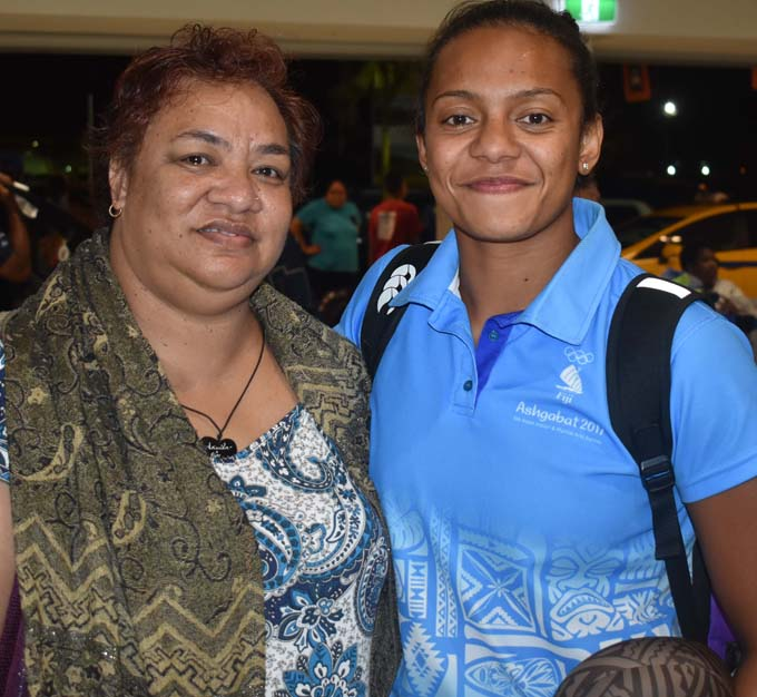 Team Fiji swimming Merelita Buadromo with her Mum Tipo Buadromo at the Nadi International Airport on October 1, 2017.  Photo: Waisea Nasokia