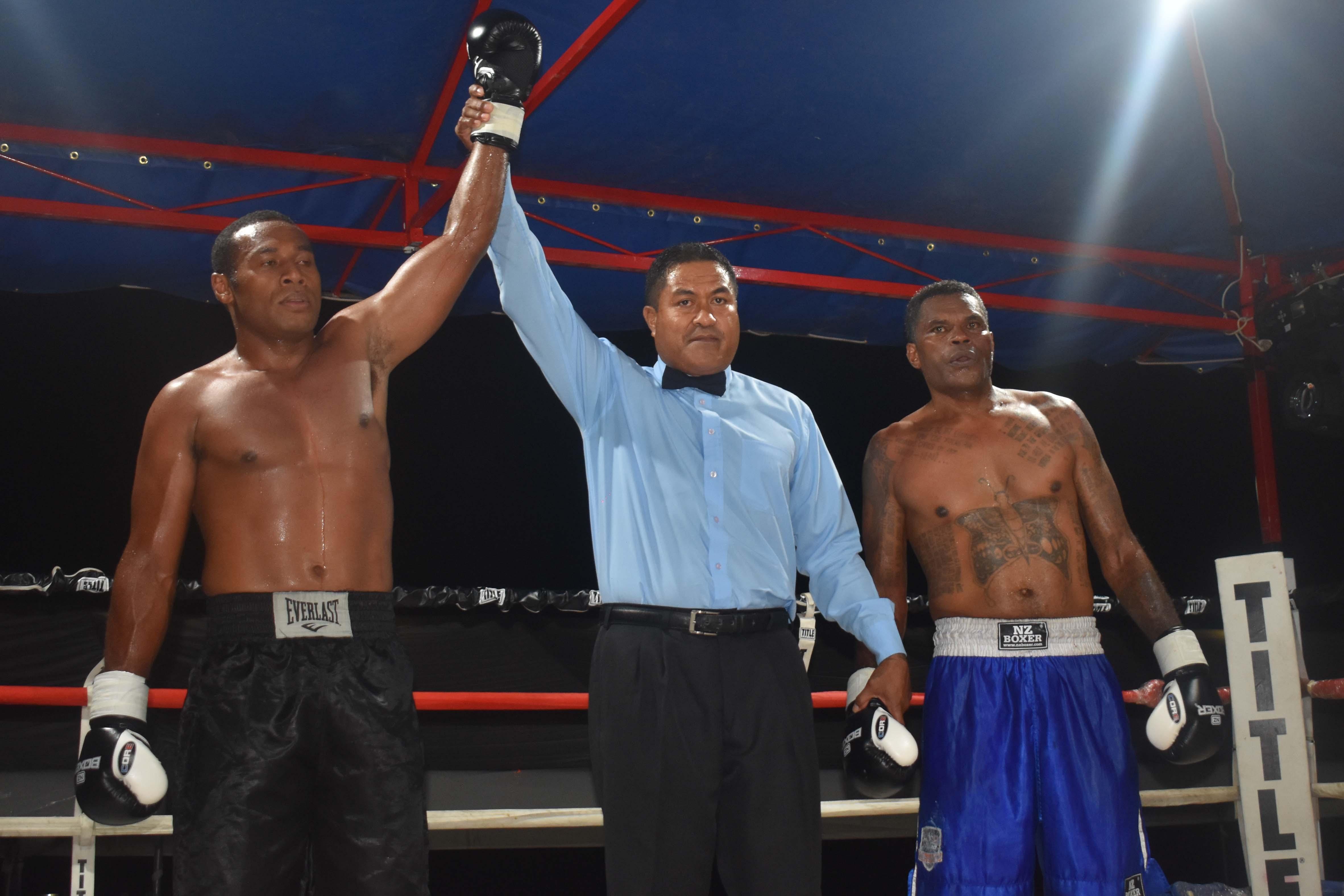 Savenaca Naliva wins over Sakiusa Mekemeke in the boxing programme at the Prince Charles Park in Nadi last night. Photo: WAISEA NASOKIA