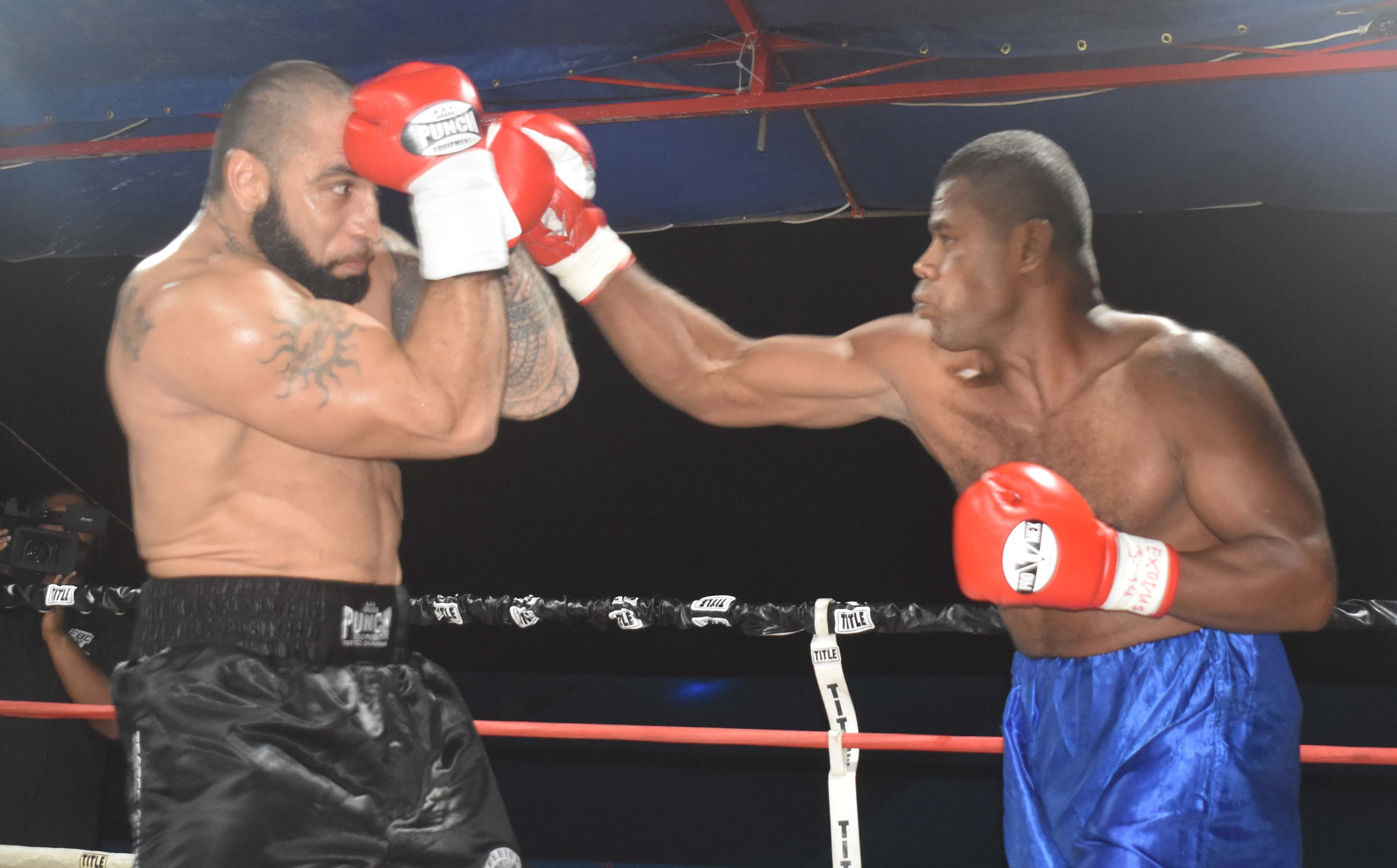 Napoleon Taumaipeau blocks a shot from Vilimoni Taganikoro in the boxing programme at the Prince Charles Park in Nadi last night. Photo: WAISEA NASOKIA