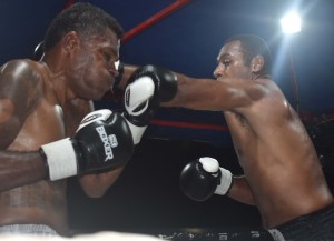 Savenaca Naliva throws left at Sakiusa Mekemeke in the boxing programme at the Prince Charles Park in Nadi last night. Photo: WAISEA NASOKIA