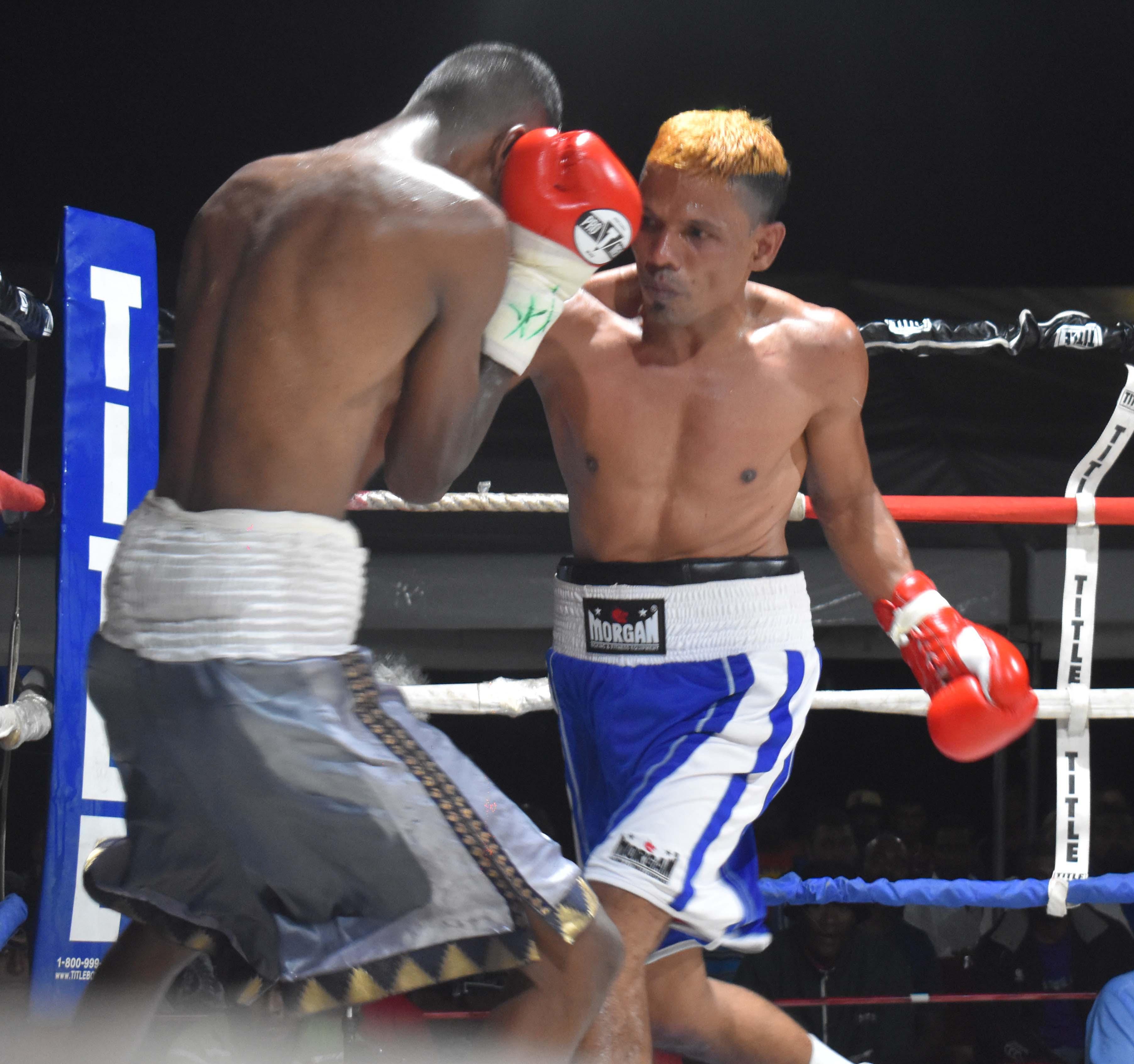 Krishneel Mudaliar blocks junior Farzan in the boxing programe at the Prince Charles Park in Nadi last night. Photo: WAISEA NASOKIA