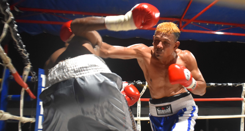Krishneel Mudaliar beats junior Farzan in the boxing programe at the Prince Charles Park in Nadi last night. Photo: WAISEA NASOKIA