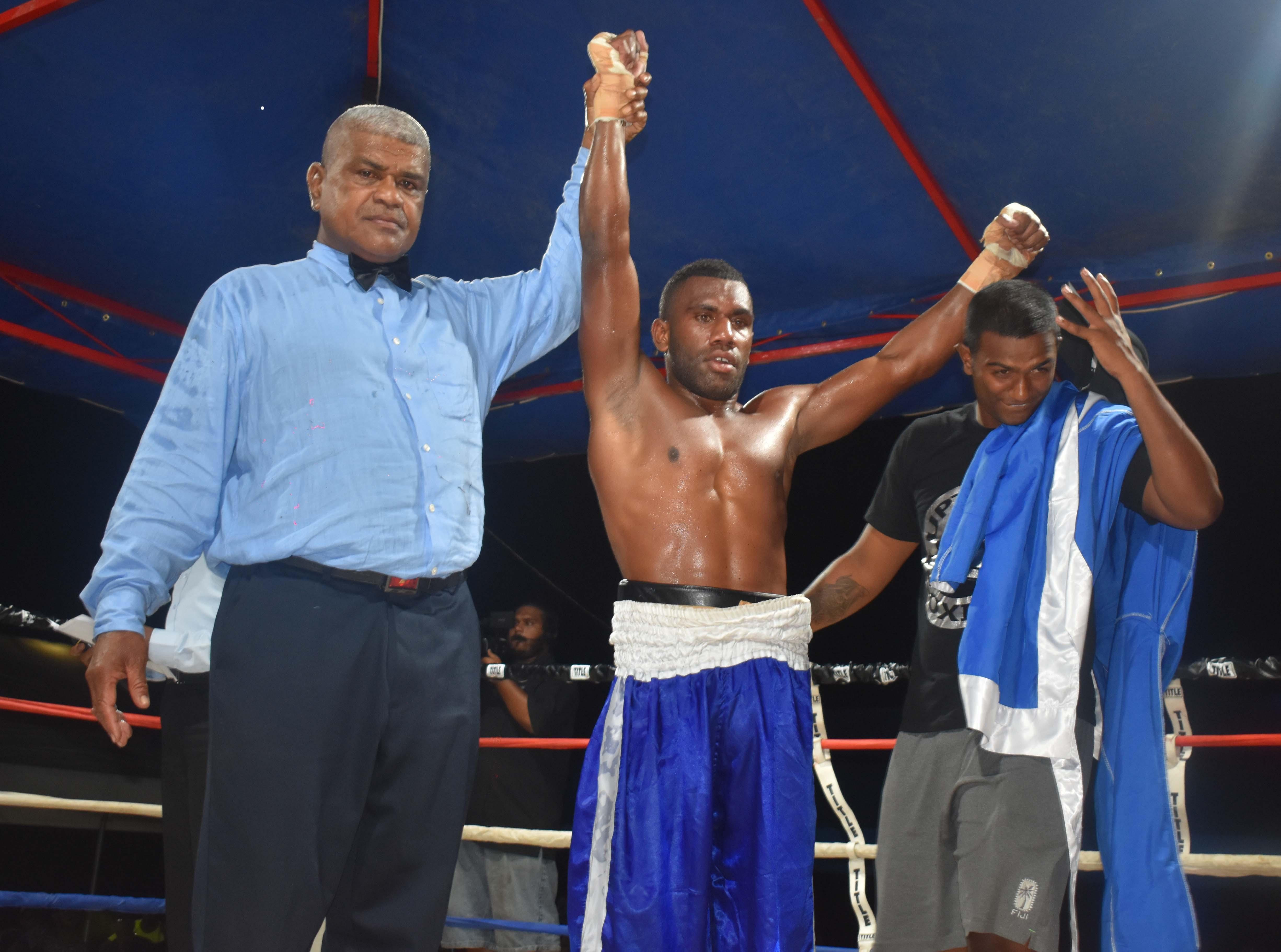 Malakai Marama wins over Rahul Pillay in the boxing programe at the Prince Charles Park in Nadi last night. Photo: WAISEA NASOKIA