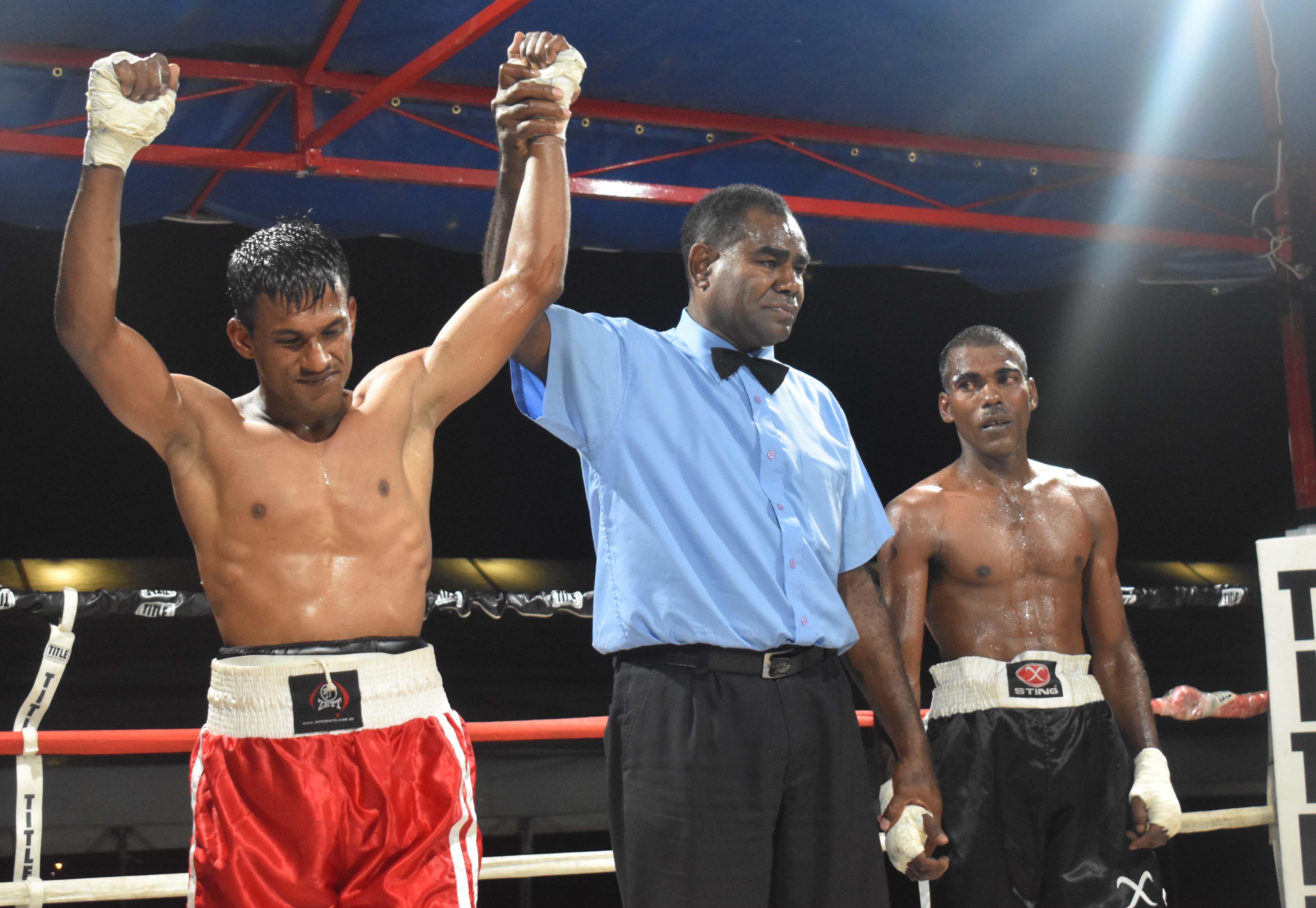 Shamal Ramanuj wins over Ritesh Gounder in the boxing programe at the Prince Charles Park in Nadi last night. Photo: WAISEA NASOKIA