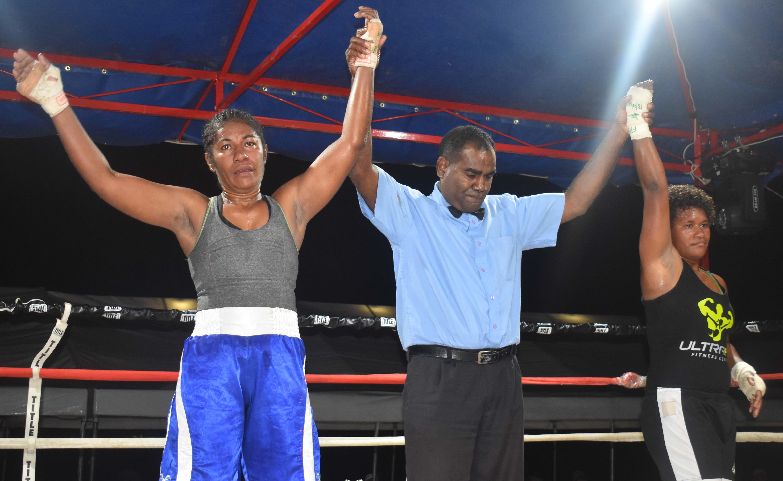 Anaseini Dakua goes against Visila Kolitapa in the boxing programme at the Prince Charles Park in Nadi last night. Photo: WAISEA NASOKIA