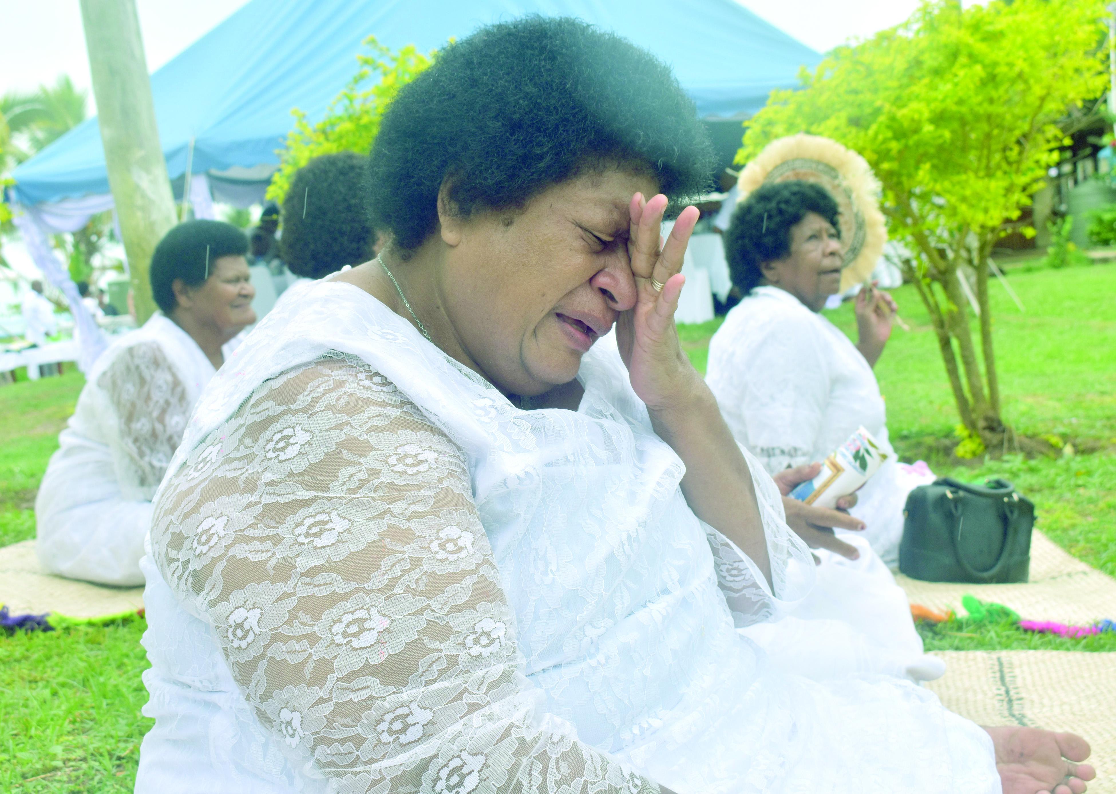 Adi Merewai Lalabalavu weaps beside the chiefly burial site where her husband Momo Na Tui Lawa, Ratu Sevanaia Lalabalavu was laid to rest on 22 November 2017. Photo: Arieta Vakasukawaqa