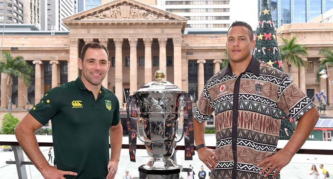 Kangaroos captain Cameron Smith and Vodafone Fijian squad member Kane Evans pose with the World Cup during a Rugby League World Cup civic reception at King George Square