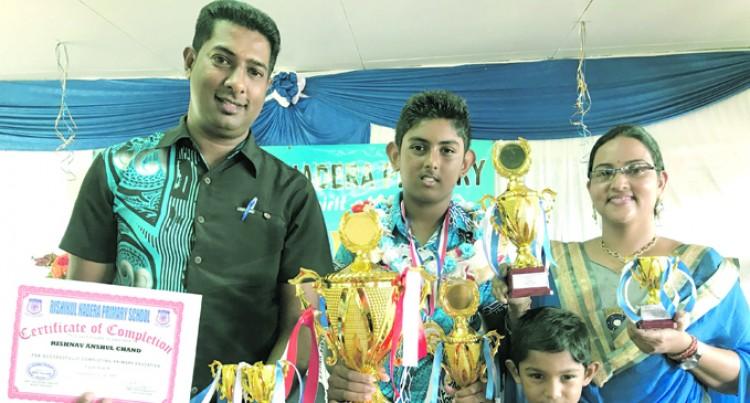 Parents Watch Rishnav Receive Top Prize