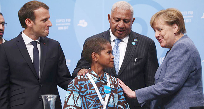 Young Timoci Naulusala with (from left) French President Emmanuel Macron, Prime Minister and COP23 President Voreqe Bainimarama, German Chancellor Angela Merkel and United Nations Secretary-General António Guterresin Bonn, Germany. Photo: DEPTFO News