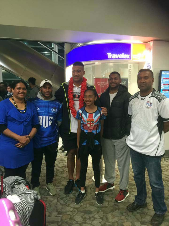 Vodafone Fijian Bati  rep Viliame Kikau(third from left) with fans at Wellington Airport on November 12, 2017.  Photo: Luse Tiqatabua