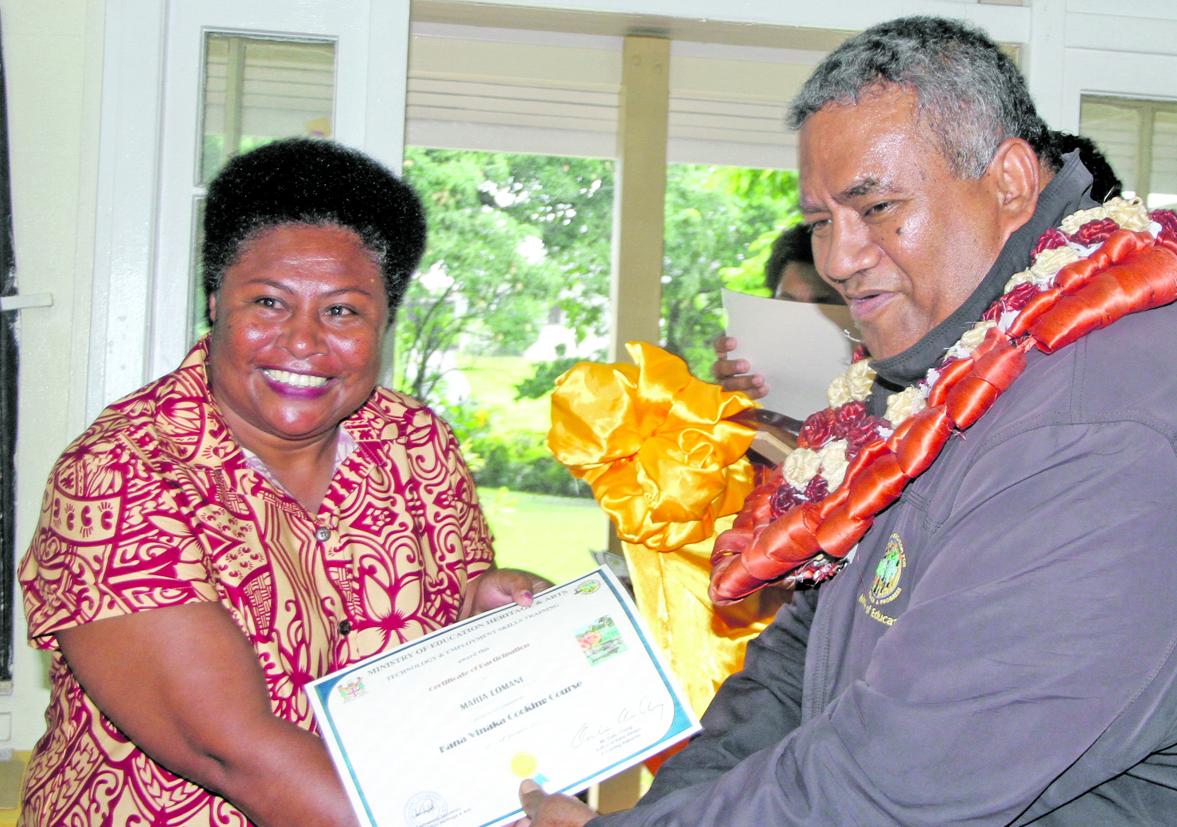 Maria Lomani receives Kana Vinaka cooking course certificate from Ministry of Education Permanent Secretary Iowane Tiko  at Technical College Suva on December 14, 2017. Photo: Ronald Kumar.