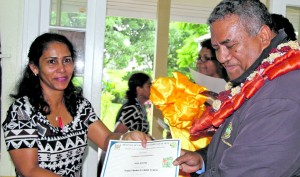Rina Khatri receives Kana Vinaka cooking course certificate from Ministry of Education Permanent Secretary Iowane Tiko  at Technical College Suva on December 14, 2017. Photo: Ronald Kumar.