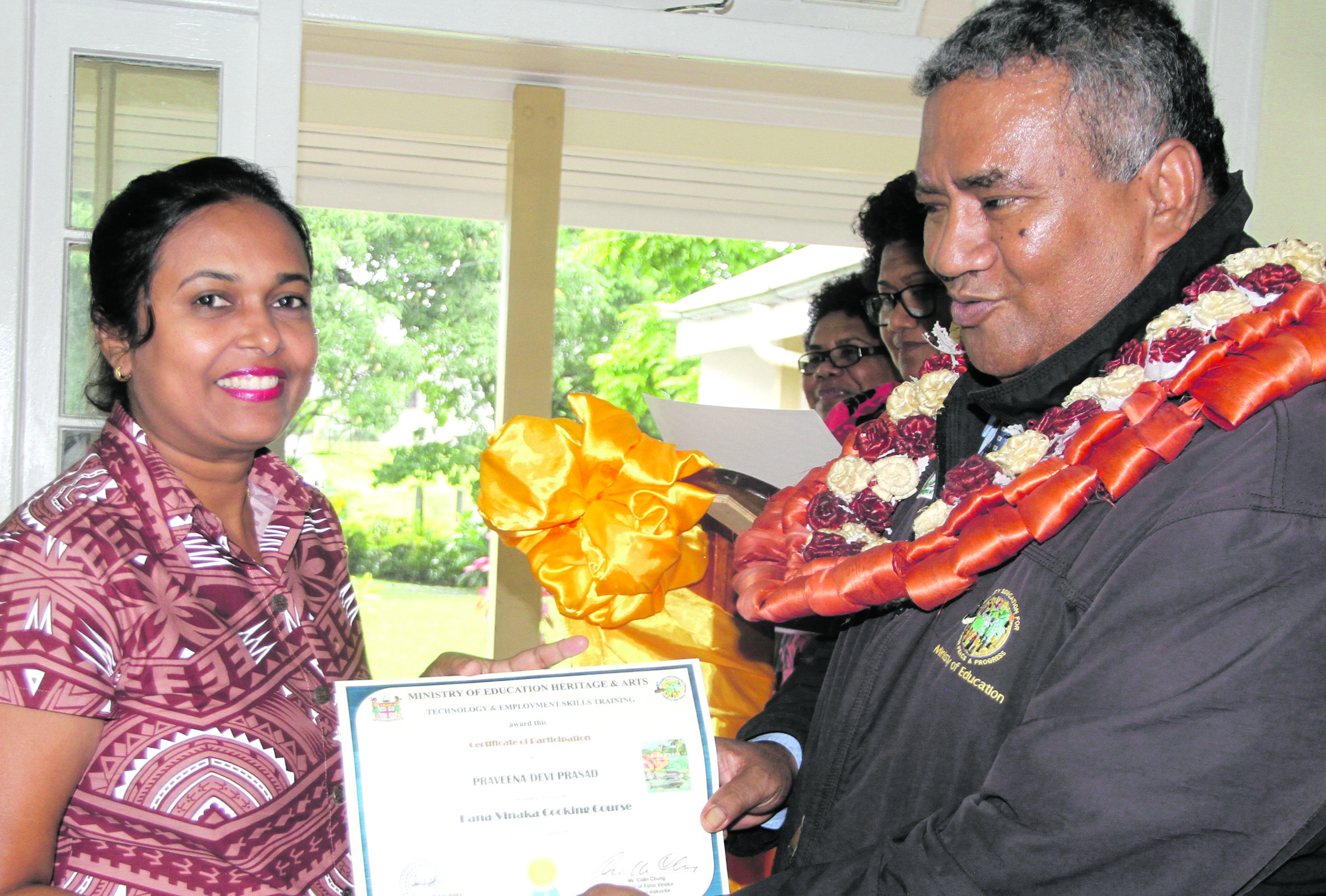 Praveena Prasad receives Kana Vinaka cooking course certificate from Ministry of Education Permanent Secretary Iowane Tiko  at Technical College Suva on December 14, 2017. Photo: Ronald Kumar.
