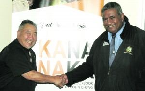 Colin Chung (left) the author of the cook book, Kana Vinaka with Ministry of Education Permanent Secretary Iowane Tiko  at Technical College Suva on December 14, 2017. Photo: Ronald Kumar.