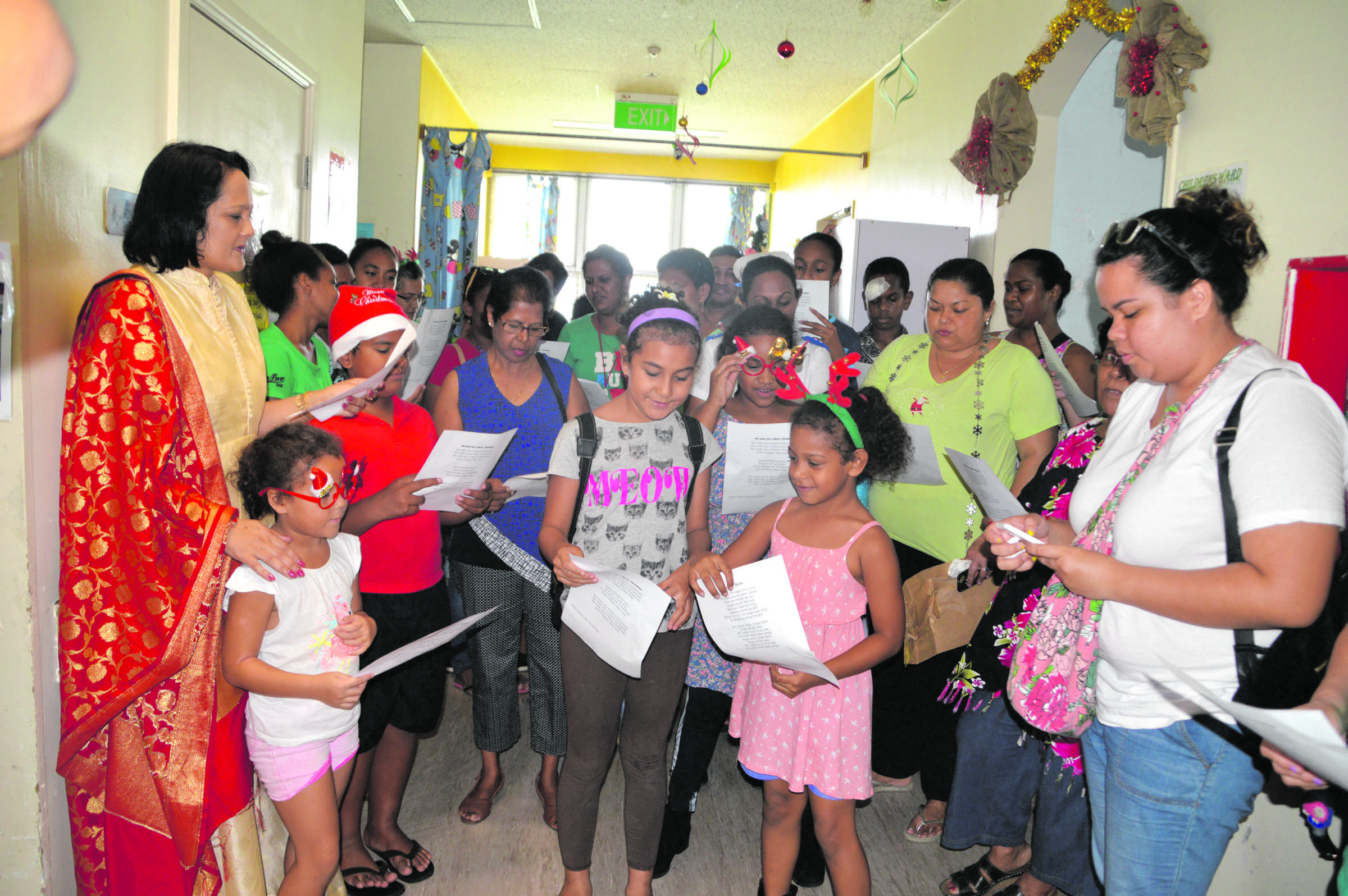 Minister for Health and Medical Services Rosy Akbar with some International School Suva primary students at the Colonial War Memorial Hospital Children's Ward on December 9, 2017.  Photo: Ministry of Health and Medical Services