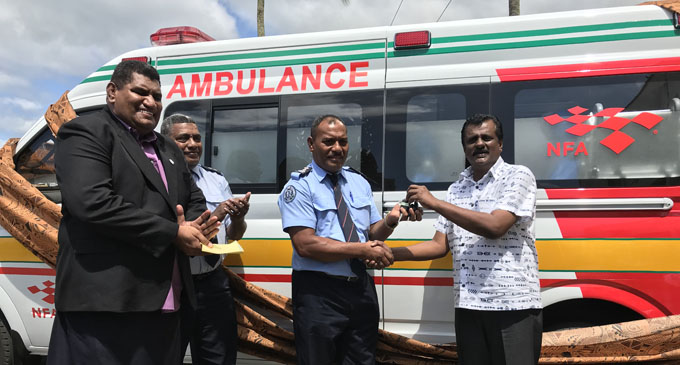 National Fire Authority board chairman John O'Connor (left) joins the NFA chief fire officer Qionilau Moceitai (middle) in receiving the keys of the three new ambulances handed over by the Minister for Local Government, Housing, Environment, Infrastructure and Transport Parveen Bala on December 28, 2017. Photo: Ashna Kumar