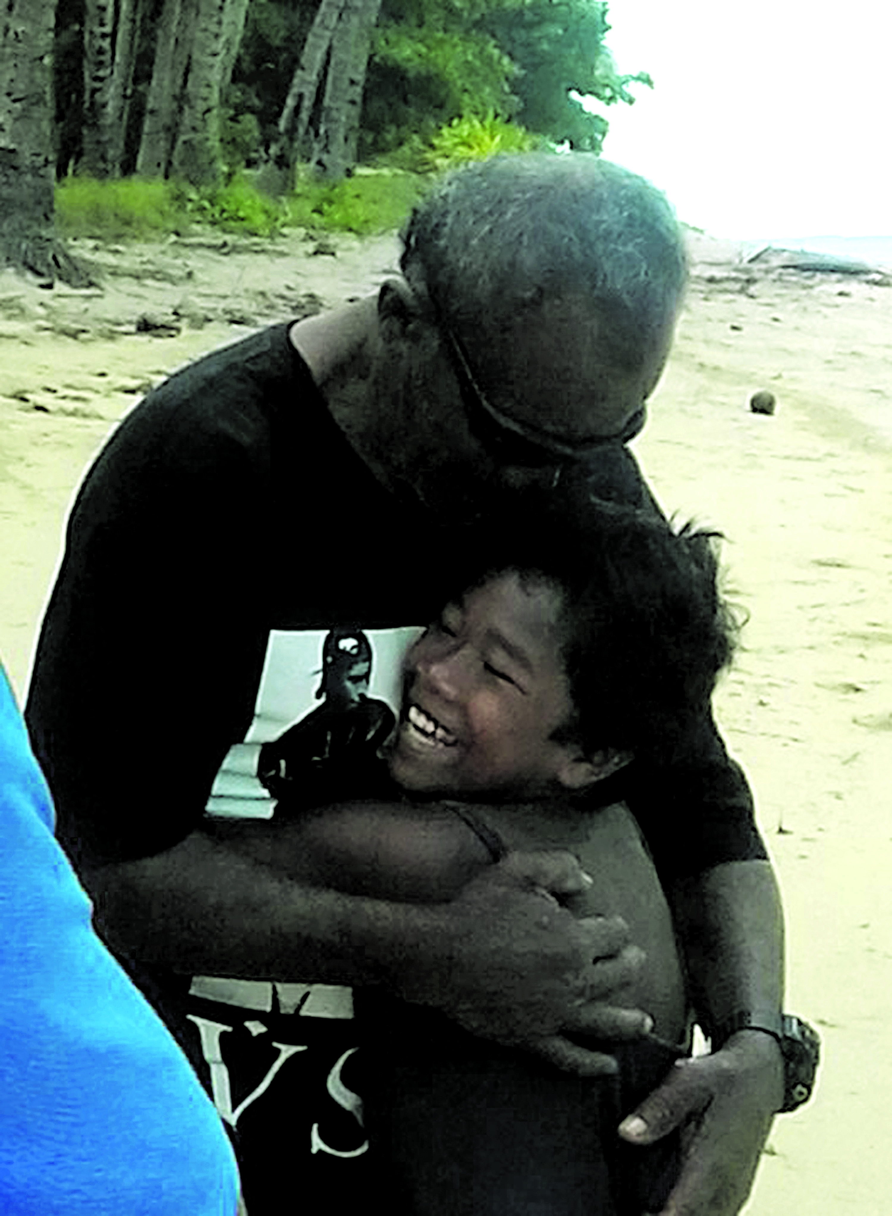 Tavo Takayawa hugs his granddaughter at Udu Village on Totoya, Lau.  Photo: Mereseini Luvu