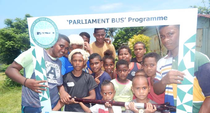 Children of Naiseuseu Village in Beqa take a selfie after the Parliament Bus programme.