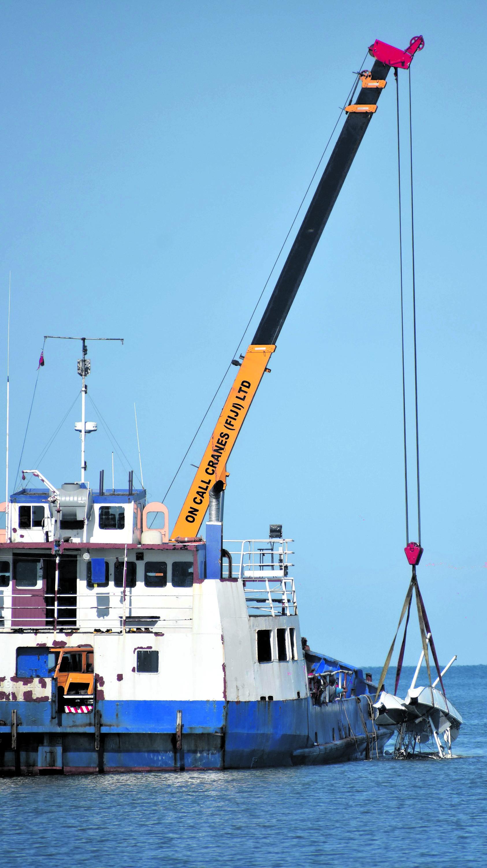 Turtle Airways sea plane being salvaged in Wailoaloa, Nadi yesterday. Photo: WAISEA NASOKIA