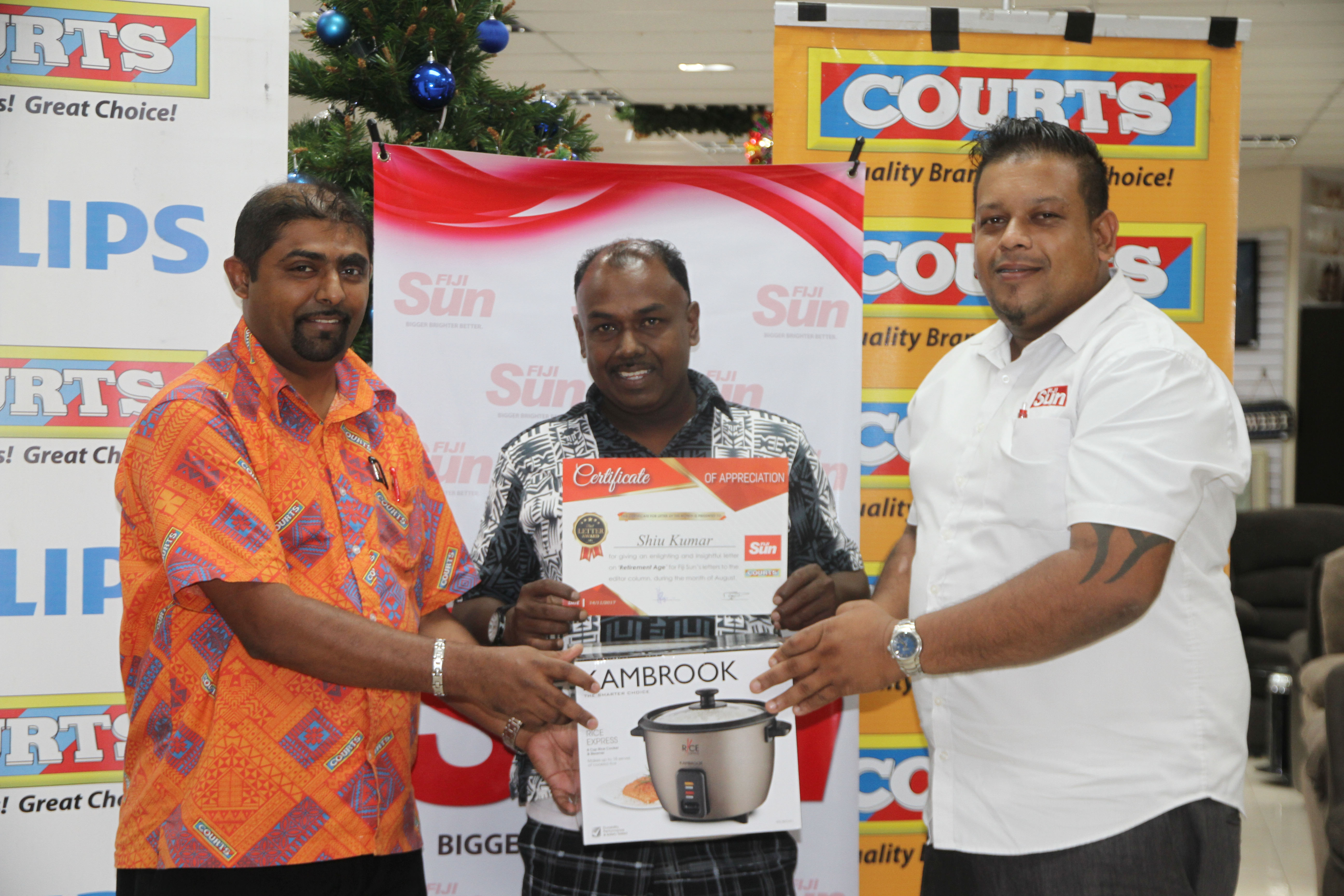 From left: Courts Retail Manager Benjamin Mohammed, Shiu Kumar and Fiji Sun marketing manager Rajiv Raj at the Courts Rodwell branch in Suva on December 12, 2017.  Photo: Wati Talebula