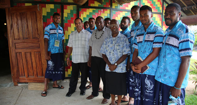 Vanuatu Lands Minister Ralph Regenvanu (left) and Chief Isaac Woroworo (middle) pose with the Team Fiji men's football team after the church service in Port Vila, Vanuatu, on December 3, 2017.  Photo: Peni Komaisavai