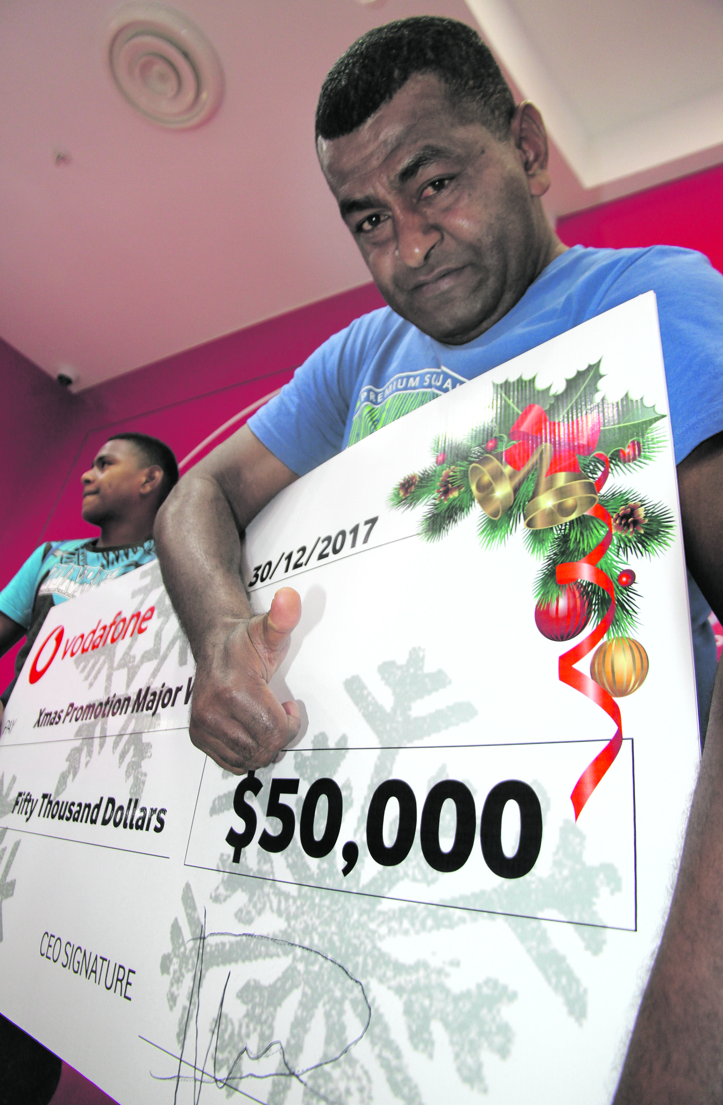 Vodafone Christmas promotion $50,000 winner, Sailusi Vodonaivalu at the Vodafone branch at MHCC in Suva on December 30, 2017.  Photo: Ronald Kumar