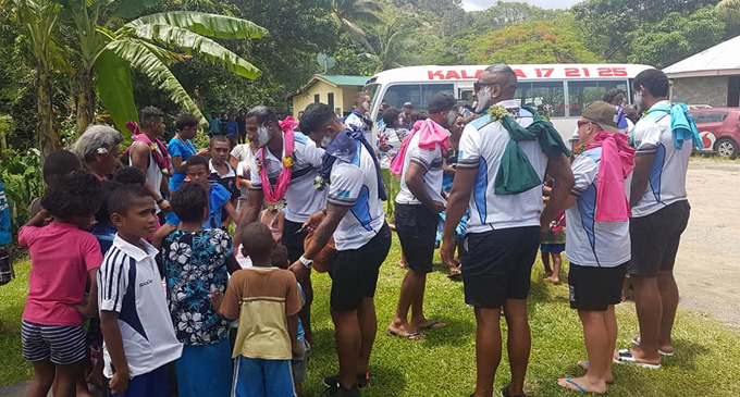 Vodafone Fijian Bati reps Suliasi Vunivalu and Joe Lovodua with fans at Votua Village, Coral Coast on December 1, 2017. Photo: William Tabuya on Vodafone Fiji