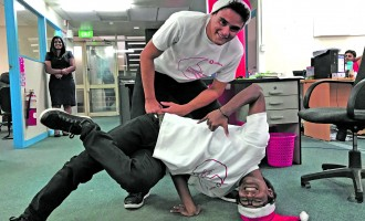 'Popping' Dance Duo Spread Christmas Message at Offices