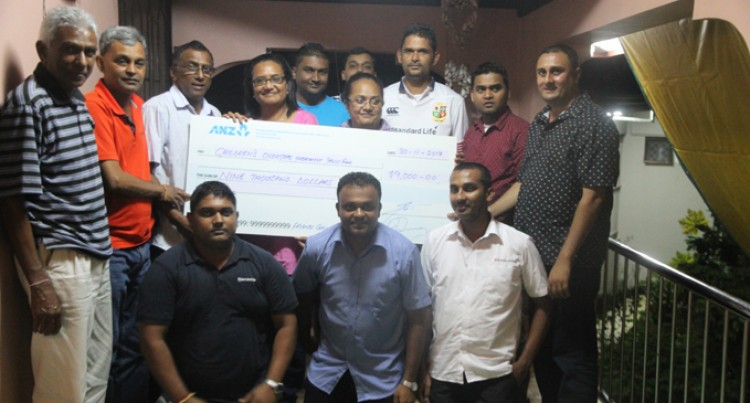 Grog Buddies Donate $9000 to Children With Cancer