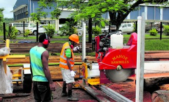 Forestry Minister Impressed With Chipper, Sawmill Machine