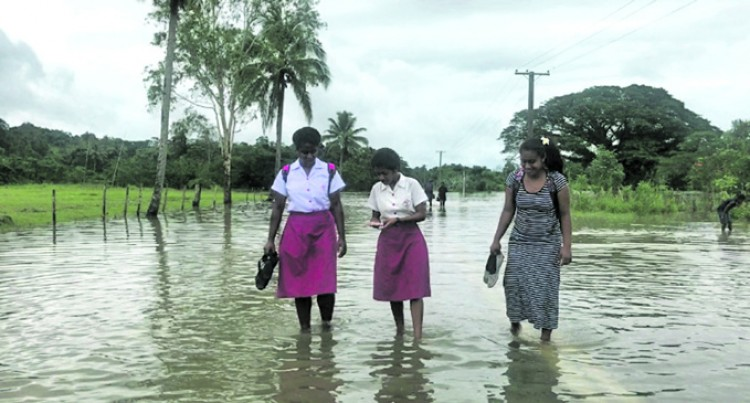ACS Students Brave Floods to Attend Class