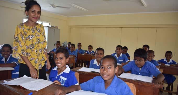 Some students of Balevuto Primary School with their teacher inside one of the new classrooms on January 26, 2018. Photo: Waisea Nasokia