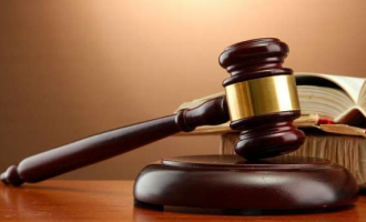 Robbery Accused Freed by Judge, Trial Questioned