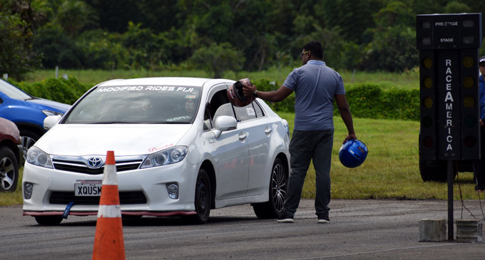 Fiji Car Club official ensures that all safety equipments are worn during the draf race at the Nanuku Aerodrome in Pacific Harboure, Deuba on December 31, 2017. Photo: Vilimoni Vaganalau