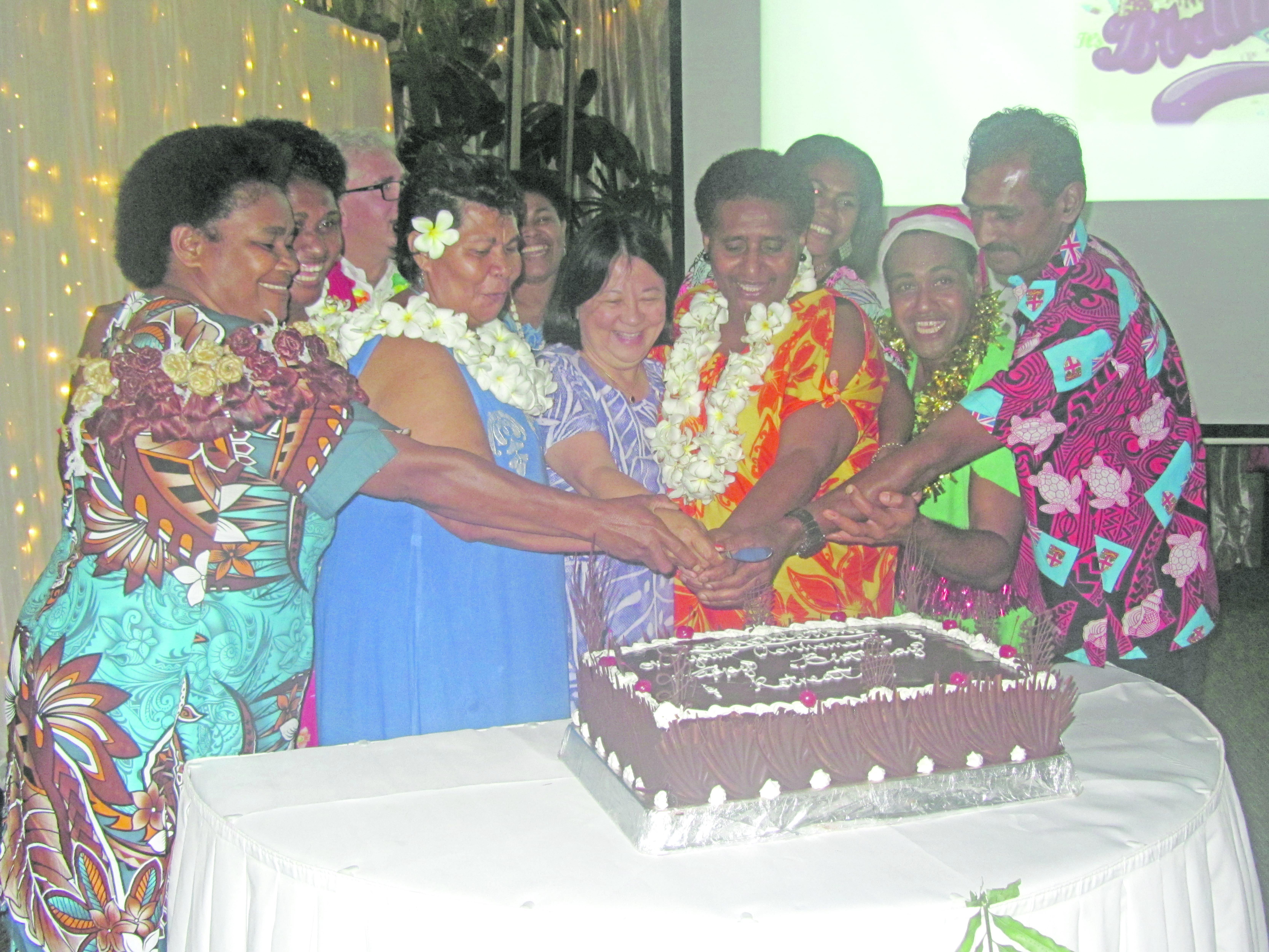 Warwick Fiji staff cut the cake during the resort's annual staff award night .  Photo: Warwick Fiji