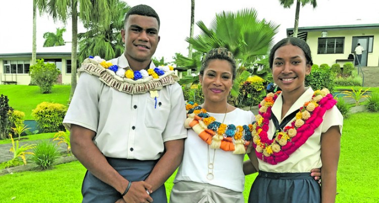 Fiji LDS Church College badges its headboy, headgirl