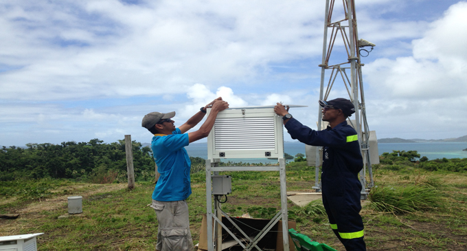 Fiji Meteorological Services officers install new equipment for the new cyclone season 2017-2018. Photo: Pacific Building Solutions