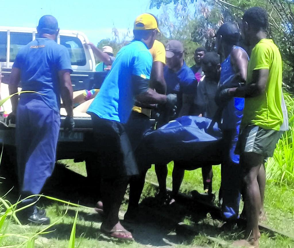 The body of Ratu Jope Sigaruarua being lifted on the police vehicle at Vuda in Lautoka on January 04,2018. PHOTO: KARALAINI TAVI.
