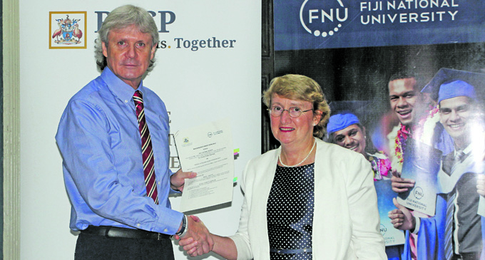 FNU Vice Chancellor, Professor Nigel Healey (left), with Royal Australasian College of Physicians (RACP) president, Dr Catherine Yelland on January 22, 2018. Photo: Fiji National University
