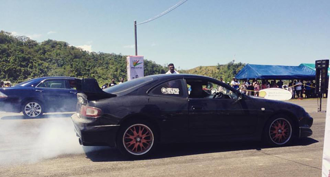Pacific Energy quarter mile drag race marshal keeps a close look at the start of one of the races. Photo:  Fiji Car Club