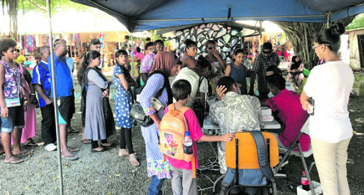 Parents, Guardians Turn Up in Numbers to Top Up e-Cards
