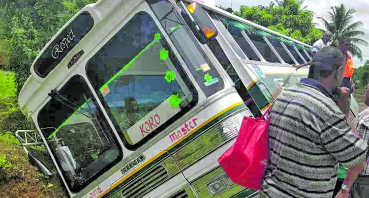 No Injuries After Island Bus Falls Into Drain