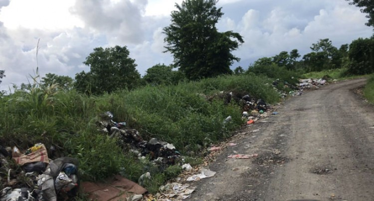 Rubbish piles, no lights, but cars park in 'Lovers Lane'