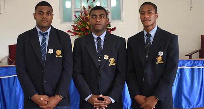 QVS deputy headboys Alipate Vananalagi (left), and Rupeni Caucau (right), with 2018 headboy Aisake Matarerega after the induction ceremony at Queen Victoria School, Tailevu, on February 4, 2018.  Photo: Losirene Lacanivalu