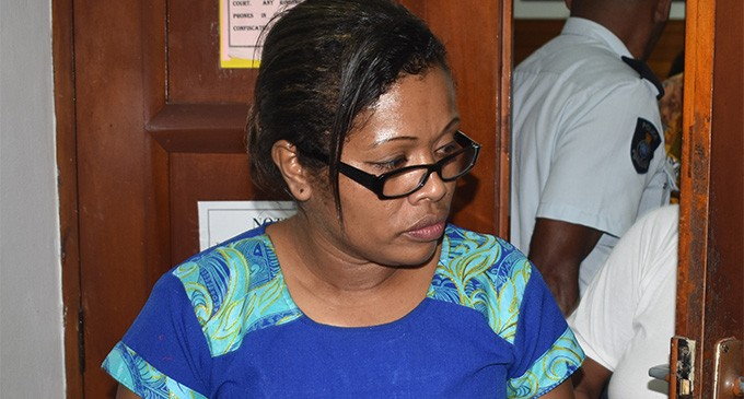 Woman allegedly rapes female while she slept